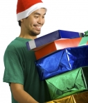 Man carrying pile of Christmas presents