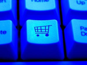 shopping cart on computer keyboard