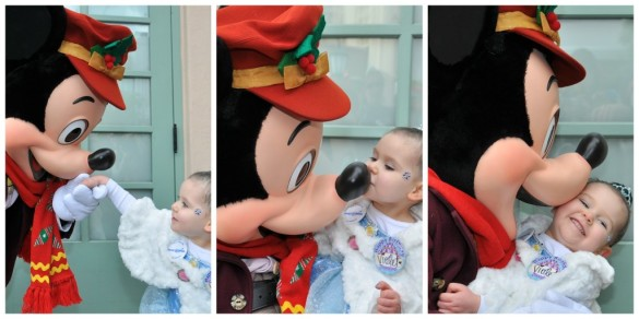 A toddler being swept off her feet by Mickey Mouse